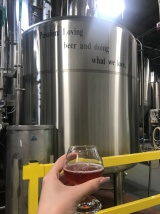 Words of Wisdom and one of the MANY free beers from the tour - Diana Gebbia Photo